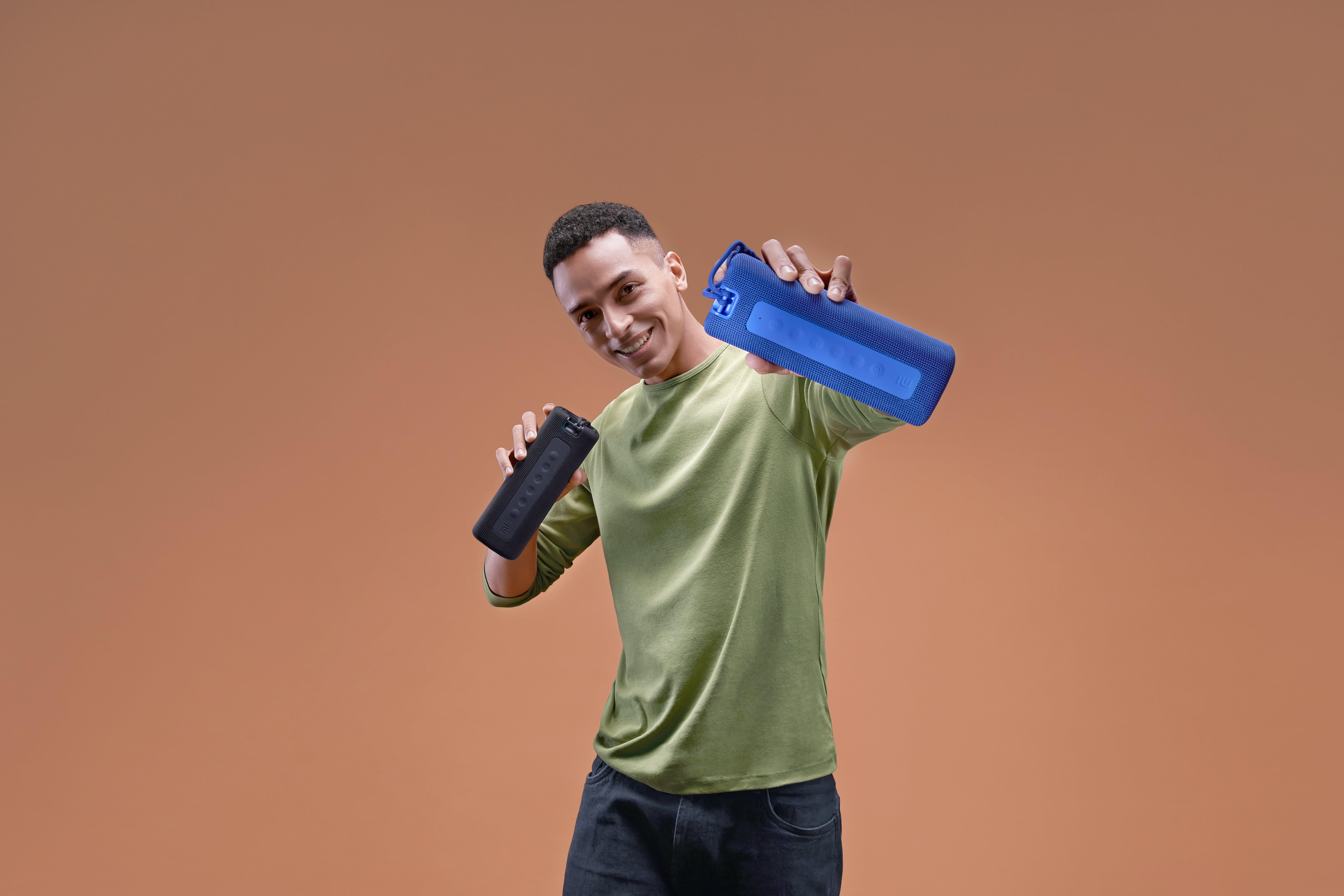 Man with Mi Portable Bluetooth Speaker 16W